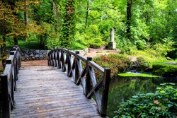 Beautiful little wooden bridge across river in the Sofia Park,  Uman, Ukraine ,autumn, summer, spring, picturesque