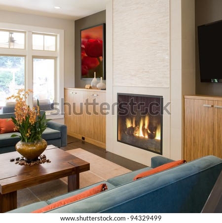 Beautiful Living Room in New Home with Fire in Fireplace