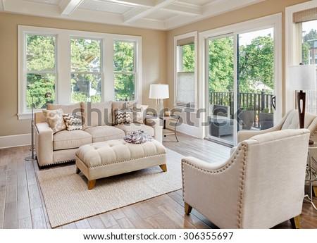 Beautiful living room with hardwood floors in new luxury home #306355697