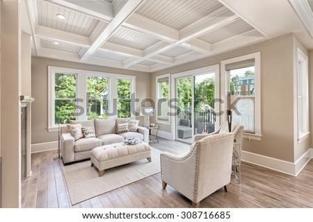 Beautiful living room with hardwood floors in new luxury home #308716685