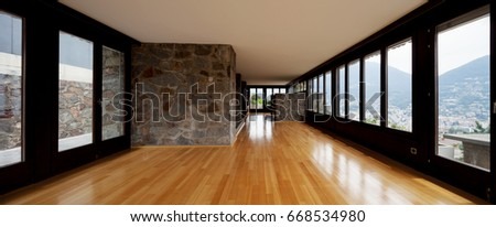 Beautiful living room with stone and wide glass. Nobody inside #668534980