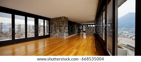 Beautiful living room with stone and wide glass. Nobody inside #668535004