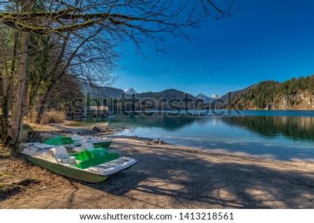 Beautiful location: Boat at a idyllic lake #1413218561