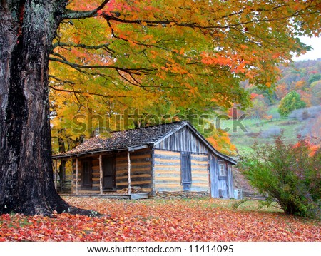 Beautiful log cabin during fall peak season in the mountains.