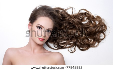 Beautiful long curly hair of young woman - white background