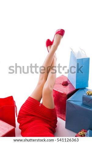 Beautiful long female legs in red shose, near many gift boxes. Isolated on white - Shutterstock ID 541126363