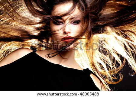 beautiful long hair brunette with hair in motion, studio shot