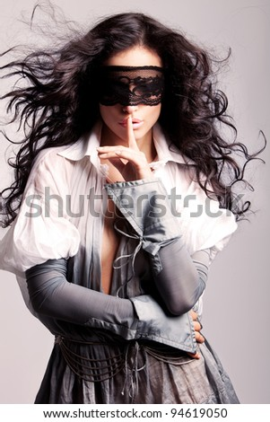beautiful long hair brunette with mask on her eyes
