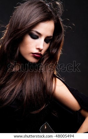 beautiful long hair brunette woman portrait, studio shot