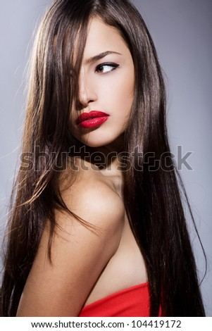 beautiful long hair young woman with red lips and dress
