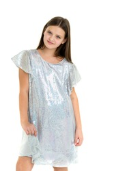 Beautiful long haired girl in shiny trendy dress