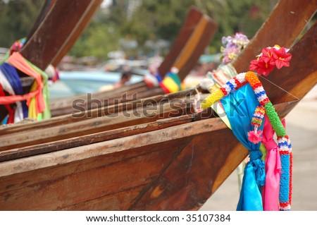 beautiful longtail boats on the sand seashore