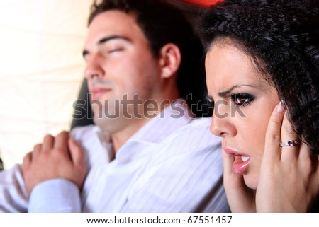 Beautiful loving couple at home watching tv man is sleeping - stock photo
