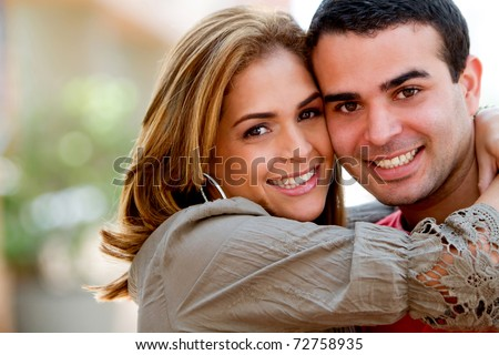 Beautiful loving couple hugging and having fun