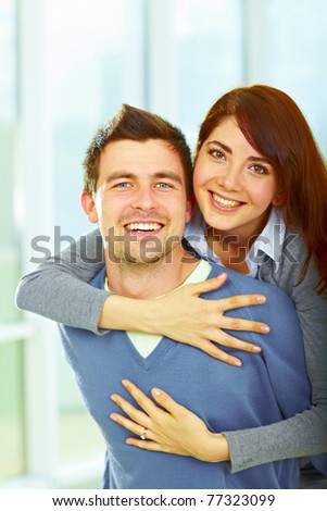 Beautiful loving couple hugging and looking happy