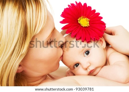 beautiful loving mother kissing baby girl, mother's love on white
