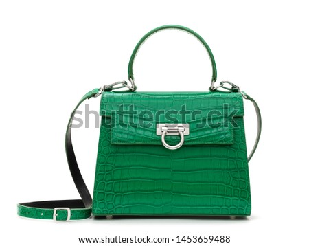 Beautiful luxurious bright green crocodile leather handbag , front view, with a shadow on a white background