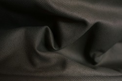 beautiful luxurious shadow khaki fabric background, detail of wavy opaque fabric background, closeup crumpled textile shiny khaki color