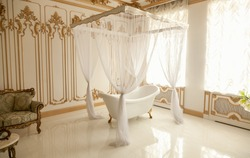 Beautiful luxury bathroom with big window and baldachin