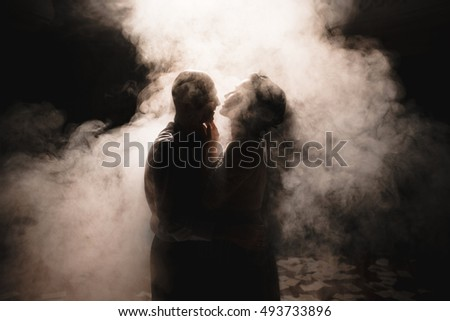 Beautiful luxury couple in the smoke