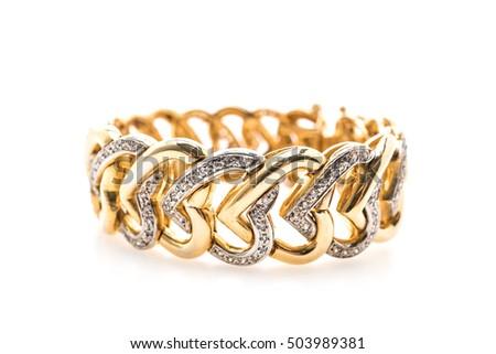 Beautiful luxury Gold bracelet and diamond jewelry isolated on white background