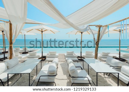 Beautiful luxury swimming pool on sea view and umbrella and chair in hotel resort #1219329133