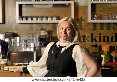 Beautiful maid at coffee shop - stock photo