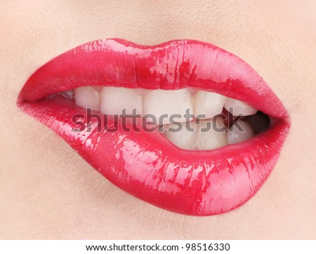 beautiful make up of glamour red gloss lips