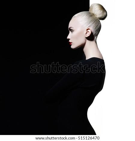 Beautiful makeup. Sexy woman with art makeup. Beautiful blonde with sexy evening makeup and black dress.