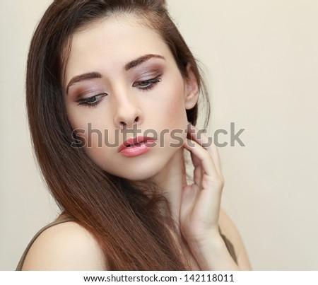 Beautiful makeup woman face looking down. Closeup portrait