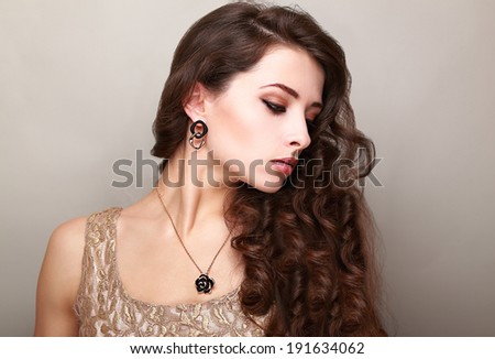 Beautiful makeup woman with long bright curly hair. Female profile