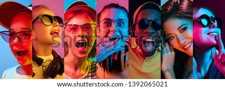 Beautiful male and female front portrait isolated on multicolored neon light backgroud. Young, smiling, surprised, screaming. Human emotions, facial expression concept. Trendy colors. Creative collage #1392065021