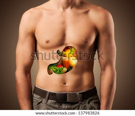 Beautiful male torso. Healthy food.. Fitness