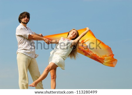 Beautiful man and the woman on a summer field