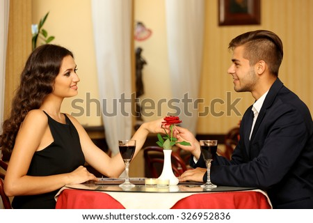 beautiful man and woman are flirting at the restaurant