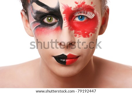 Beautiful man with abstract make up and different color in his eyes