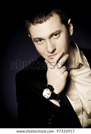 Beautiful man with watch on a dark background