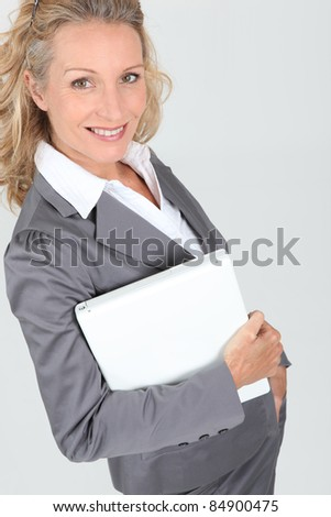 Beautiful manager holding laptop computer