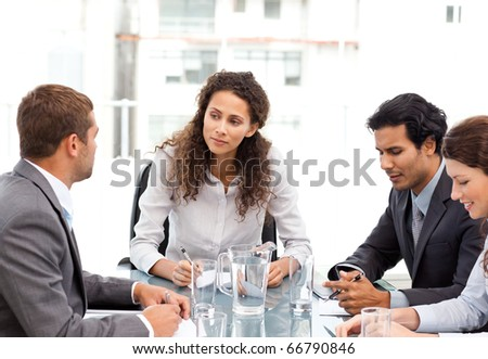 Beautiful manager speaking with her team during a meeting at the office