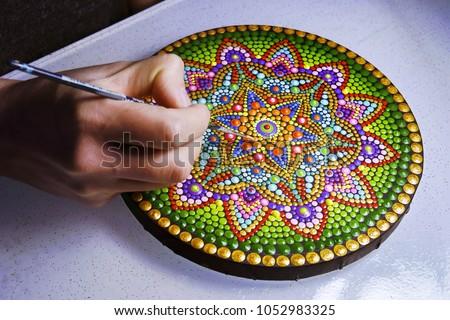 beautiful mandala painted with a brush closeup view #1052983325
