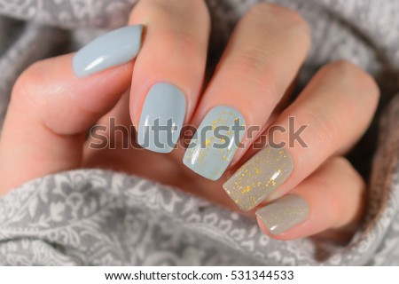 beautiful manicure. Gel polish coating in blue