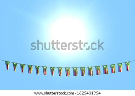 beautiful many Comoros flags or banners hangs on string on blue sky background - any celebration flag 3d illustration