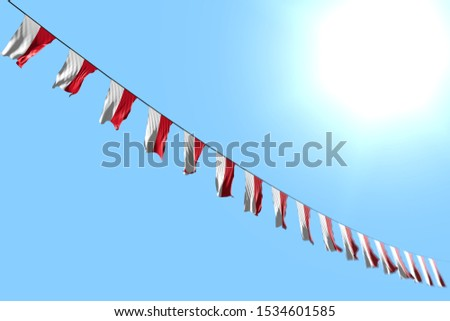 beautiful many Indonesia flags or banners hangs diagonal on rope on blue sky background with bokeh - any feast flag 3d illustration