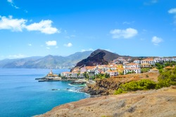 Beautiful Marina da Quinta Grande in Madeira island, Portugal. Small village, harbour located by Ponta de Sao Lourenco. Rocks and hills behind the city by the Atlantic ocean. Cityscape. Travel places.