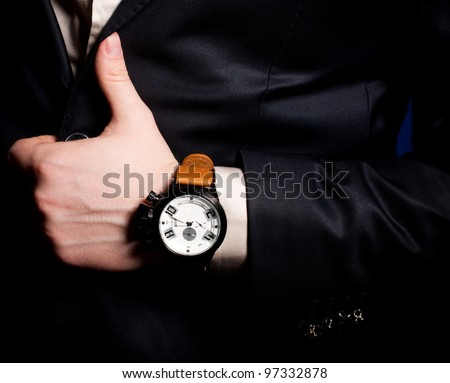 Beautiful masculine hand with a clock