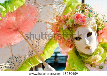 Beautiful mask with umberella in Venice, Italy. - stock photo