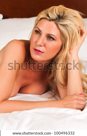 stock photo beautiful mature blonde nude in bed 100496332 Now just imagine shooting a hardcore porn scene right at the office, ...