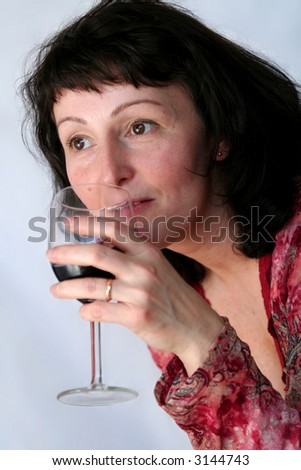 stock photo : Beautiful mature brunette with glass of wine