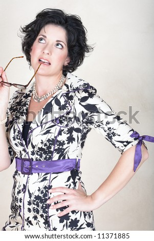 stock photo : Beautiful mature business woman with black curly hair and soft ...