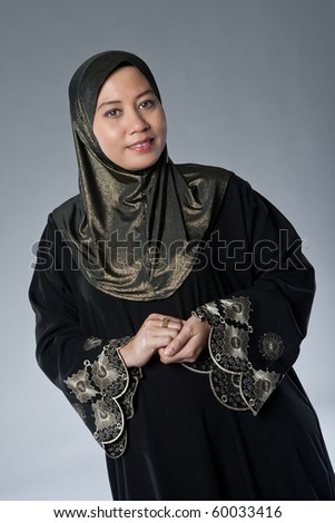 stock photo beautiful mature muslim malay woman in studio 60033416 stock photo : Beautiful mature Muslim woman in scarf. Save to a lightbox ▼